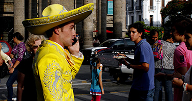 Mariachi using mobile phone
